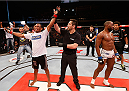 BRASILIA, BRAZIL - SEPTEMBER 13:  Francisco Trinaldo (L) of Brazil celebrates after his unanimous-decision victory over Leandro Silva of Brazil in their lightweight bout during the UFC Fight Night event inside Nilson Nelson Gymnasium on September 13, 2014 in Brasilia, Brazil.  (Photo by Josh Hedges/Zuffa LLC/Zuffa LLC via Getty Images)