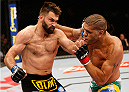 "BRASILIA, BRAZIL - SEPTEMBER 13: (R-L) Antonio ""Bigfoot"" Silva of Brazil and Andrei Arlovski of Belarus trade punches in their heavyweight bout during the UFC Fight Night event inside Nilson Nelson Gymnasium on September 13, 2014 in Brasilia, Brazil. (Photo by Josh Hedges/Zuffa LLC/Zuffa LLC via Getty Images)"
