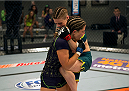 LAS VEGAS, NV - JULY 10:  (R-L) Team Pettis fighter Joanne Calderwood knees team Melendez fighter Emily Kagan during filming of season twenty of The Ultimate Fighter on July 10, 2014 in Las Vegas, Nevada. (Photo by Brandon Magnus/Zuffa LLC/Zuffa LLC via Getty Images) *** Local Caption *** Joanne Calderwood;Emily Kagan