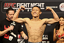 SAITAMA, JAPAN - SEPTEMBER 19: Kyoji Horiguchi steps on the scale during the UFC Fight Night weigh-in event on September 19, 2014 in Saitama, Japan. (Photo by Mitch Viquez/Zuffa LLC/Zuffa LLC via Getty Images)