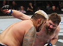 SAITAMA, JAPAN - SEPTEMBER 20: Roy Nelson throws a punch at Mark Hunt in their heavyweight bout during the UFC Fight Night event inside the Saitama Arena on September 20, 2014 in Saitama, Japan. (Photo by Mitch Viquez/Zuffa LLC/Zuffa LLC via Getty Images)