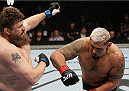 SAITAMA, JAPAN - SEPTEMBER 20:  Mark Hunt throws a punch at Roy Nelson in their heavyweight bout during the UFC Fight Night event inside the Saitama Arena on September 20, 2014 in Saitama, Japan. (Photo by Mitch Viquez/Zuffa LLC/Zuffa LLC via Getty Images)