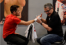 LAS VEGAS, NV - JUNE 3:  Team Velasquez fighter Henry Briones gets his hands wrapped before facing team Werdum fighter Marlon Vera in their preliminary fight during filming of The Ultimate Fighter Latin America on June 3, 2014 in Las Vegas, Nevada. (Photo by Jeff Bottari/Zuffa LLC/Zuffa LLC via Getty Images) *** Local Caption *** Henry Briones