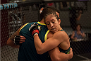 LAS VEGAS, NV - JULY 15:  Team Pettis fighter Jessica Penne hugs Head Coach Anthony Pettis after defeating team Melendez fighter Lisa Ellis during filming of season twenty of The Ultimate Fighter on July 15, 2014 in Las Vegas, Nevada. (Photo by Brandon Magnus/Zuffa LLC/Zuffa LLC via Getty Images) *** Local Caption *** Jessica Penne;Anthony Pettis