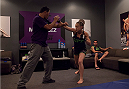 LAS VEGAS, NV - JULY 15:  Team Melendez fighter Lisa Ellis warms up before facing team Pettis fighter Jessica Penne during filming of season twenty of The Ultimate Fighter on July 15, 2014 in Las Vegas, Nevada. (Photo by Brandon Magnus/Zuffa LLC/Zuffa LLC via Getty Images) *** Local Caption *** Lisa Ellis