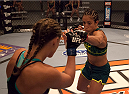 LAS VEGAS, NV - JULY 15:  (R-L) Team Pettis fighter Jessica Penne punches team Melendez fighter Lisa Ellis during filming of season twenty of The Ultimate Fighter on July 15, 2014 in Las Vegas, Nevada. (Photo by Brandon Magnus/Zuffa LLC/Zuffa LLC via Getty Images) *** Local Caption *** Jessica Penne;Lisa Ellis
