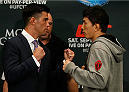 LAS VEGAS, NV - SEPTEMBER 25:  (L-R) Opponents Dominick Cruz and Takeya Mizugaki of Japan face off during the UFC 178 Ultimate Media Day at the MGM Grand Hotel/Casino on September 25, 2014 in Las Vegas, Nevada. (Photo by Josh Hedges/Zuffa LLC/Zuffa LLC via Getty Images)