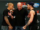 LAS VEGAS, NV - SEPTEMBER 25:  (L-R) Opponents Dustin Poirier and Conor McGregor face off during the UFC 178 Ultimate Media Day at the MGM Grand Hotel/Casino on September 25, 2014 in Las Vegas, Nevada. (Photo by Josh Hedges/Zuffa LLC/Zuffa LLC via Getty Images)