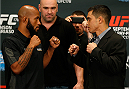 LAS VEGAS, NV - SEPTEMBER 25:  (L-R) Opponents Demetrious Johnson and Chris Cariaso face off during the UFC 178 Ultimate Media Day at the MGM Grand Hotel/Casino on September 25, 2014 in Las Vegas, Nevada. (Photo by Josh Hedges/Zuffa LLC/Zuffa LLC via Getty Images)