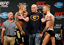 LAS VEGAS, NV - SEPTEMBER 26:  (L-R) Opponents Dustin Poirier and Conor McGregor of Ireland face off during the UFC 178 weigh-in at the MGM Grand Conference Center on September 26, 2014 in Las Vegas, Nevada. (Photo by Josh Hedges/Zuffa LLC/Zuffa LLC via Getty Images)