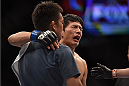 LAS VEGAS, NV - SEPTEMBER 27:  Takeya Mizugaki reacts after his TKO loss from Dominick Cruz in their bantamweight fight during the UFC 178 event inside the MGM Grand Garden Arena on September 27, 2014 in Las Vegas, Nevada.  (Photo by Jeff Bottari/Zuffa LLC/Zuffa LLC via Getty Images)