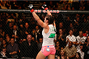 LAS VEGAS, NV - SEPTEMBER 27:  Cat Zingano celebrates after her TKO win over Amanda Nunes in their women's bantamweight fight during the UFC 178 event inside the MGM Grand Garden Arena on September 27, 2014 in Las Vegas, Nevada.  (Photo by Josh Hedges/Zuffa LLC/Zuffa LLC via Getty Images)