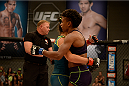 LAS VEGAS, NV - JULY 18:  Team Melendez fighter Angela Hill hugs team Pettis fighter Carla Esparza after her loss during filming of season twenty of The Ultimate Fighter on July 18, 2014 in Las Vegas, Nevada. (Photo by Brandon Magnus/Zuffa LLC/Zuffa LLC via Getty Images) *** Local Caption *** Angela Hill
