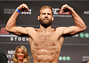 STOCKHOLM, SWEDEN - OCTOBER 03:  Tor Troeng of Sweden poses on the scale after weighing in during the UFC weigh-in at the Ericsson Globe Arena on October 3, 2014 in Stockholm, Sweden.  (Photo by Josh Hedges/Zuffa LLC/Zuffa LLC)