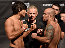 HALIFAX, NS - OCTOBER 3:  (L-R) Elias Theodorou and Bruno Santos face off during the UFC Fight Night weigh-in at the Scotiabank Centre on October 3, 2014 in Halifax, Nova Scotia, Canada. (Photo by Jeff Bottari/Zuffa LLC/Zuffa LLC via Getty Images)