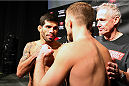 HALIFAX, NS - OCTOBER 3:  (L-R) Raphael Assuncao of Brazil and Bryan Caraway of the United States face off during the UFC Fight Night weigh-in at the Scotiabank Centre on October 3, 2014 in Halifax, Nova Scotia, Canada. (Photo by Mike Roach/Zuffa LLC/Zuffa LLC via Getty Images)