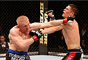 STOCKHOLM, SWEDEN - OCTOBER 04:  (L-R) Dennis Siver of Germany punches Charles Rosa in their featherweight bout at the Ericsson Globe Arena on October 4, 2014 in Stockholm, Sweden.  (Photo by Josh Hedges/Zuffa LLC/Zuffa LLC)