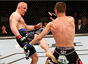 STOCKHOLM, SWEDEN - OCTOBER 04:  (L-R) Dennis Siver of Germany kicks Charles Rosa in their featherweight bout at the Ericsson Globe Arena on October 4, 2014 in Stockholm, Sweden.  (Photo by Josh Hedges/Zuffa LLC/Zuffa LLC)