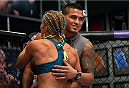 LAS VEGAS, NV - JULY 18:  Team Pettis fighter Felice Herrig hugs Head Coach Anthony Pettis after her submission victory over team Melendez fighter Heather Jo Clark during filming of season twenty of The Ultimate Fighter on July 18, 2014 in Las Vegas, Nevada. (Photo by Brandon Magnus/Zuffa LLC/Zuffa LLC via Getty Images) *** Local Caption *** Felice Herrig;Anthony Pettis