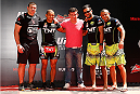 RIO DE JANEIRO, BRAZIL - OCTOBER 23:  Jose Aldo (second from left) poses with his team after an open training session for media inside Maracanã Stadium on October 23, 2014 in Rio de Janeiro, Brazil. (Photo by Josh Hedges/Zuffa LLC/Zuffa LLC via Getty Images)