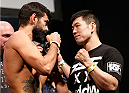 RIO DE JANEIRO, BRAZIL - OCTOBER 24:  (L-R) Opponents Yan Cabral of Brazil and Naoyuki Kotani of Japan face off during the UFC 179 weigh-in at the Maracanãzinho Gymnasium on October 24, 2014 in Rio de Janeiro, Brazil. (Photo by Josh Hedges/Zuffa LLC/Zuffa LLC via Getty Images)