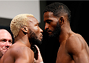 "RIO DE JANEIRO, BRAZIL - OCTOBER 24:  (L-R) Opponents William ""Patalino"" Macario of Brazil and Neil Magny face off during the UFC 179 weigh-in at the Maracanãzinho Gymnasium on October 24, 2014 in Rio de Janeiro, Brazil. (Photo by Josh Hedges/Zuffa LLC/Zuffa LLC via Getty Images)"