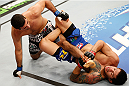RIO DE JANEIRO, BRAZIL - OCTOBER 25:  (R-L) Diego Ferreira of Brazil attempts a leg lock submission against Beneil Dariush in their lightweight bout during the UFC 179 event at Maracanazinho on October 25, 2014 in Rio de Janeiro, Brazil.  (Photo by Josh Hedges/Zuffa LLC/Zuffa LLC via Getty Images)