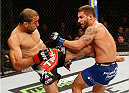 RIO DE JANEIRO, BRAZIL - OCTOBER 25:  (L-R) Jose Aldo of Brazil kicks Chad Mendes in their featherweight championship bout during the UFC 179 event at Maracanazinho on October 25, 2014 in Rio de Janeiro, Brazil.  (Photo by Josh Hedges/Zuffa LLC/Zuffa LLC via Getty Images)