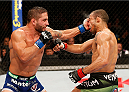 RIO DE JANEIRO, BRAZIL - OCTOBER 25:  (L-R) Chad Mendes punches Jose Aldo of Brazil in their featherweight championship bout during the UFC 179 event at Maracanazinho on October 25, 2014 in Rio de Janeiro, Brazil.  (Photo by Josh Hedges/Zuffa LLC/Zuffa LLC via Getty Images)