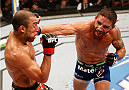 RIO DE JANEIRO, BRAZIL - OCTOBER 25:  (R-L) Chad Mendes punches Jose Aldo of Brazil in their featherweight championship bout during the UFC 179 event at Maracanazinho on October 25, 2014 in Rio de Janeiro, Brazil.  (Photo by Josh Hedges/Zuffa LLC/Zuffa LLC via Getty Images)