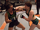 LAS VEGAS, NV - JULY 18:  (R-L) Team Pettis fighter Aisling Daly punches team Melendez fighter Angela Magana during filming of season twenty of The Ultimate Fighter on July 18, 2014 in Las Vegas, Nevada. (Photo by Brandon Magnus/Zuffa LLC/Zuffa LLC via Getty Images) *** Local Caption *** Aisling Daly;Angela Magana