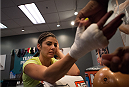 LAS VEGAS, NV - JULY 28:  Team Pettis fighter Alex Chambers gets her hands wrapped before facing team Melendez fighter Rose Namjunas during filming of season twenty of The Ultimate Fighter on July 28, 2014 in Las Vegas, Nevada. (Photo by Brandon Magnus/Zuffa LLC/Zuffa LLC via Getty Images) *** Local Caption *** Alex Chambers