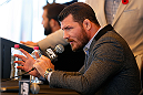 SYDNEY, AUSTRALIA - NOVEMBER 06:  Michael Bisping of England interacts with media during the UFC Fight Night press conference at the Opera Point Marquee on November 6, 2014 in Sydney, Australia. (Photo by Josh Hedges/Zuffa LLC/Zuffa LLC via Getty Images)
