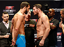 SYDNEY, AUSTRALIA - NOVEMBER 07:  (L-R) Opponents Luke Rockhold of the United States and Michael Bisping of England face off during the UFC Fight Night weigh-in at the Allphones Arena on November 7, 2014 in Sydney, Australia. (Photo by Josh Hedges/Zuffa LLC/Zuffa LLC via Getty Images)