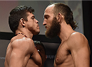 UBERLANDIA, BRAZIL - NOVEMBER 07:  (L-R) Opponents Caio Magalhaes and Trevor Smith face off during the UFC Fight Night weigh-in at Sabiazinho Gymnasium on November 7, 2014 in Uberlandia, Brazil.  (Photo by Buda Mendes/Zuffa LLC/Zuffa LLC via Getty Images)