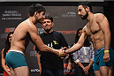 UBERLANDIA, BRAZIL - NOVEMBER 07:  (L-R) Opponents Diego Rivas and Rodolfo Rubio face off during the UFC Fight Night weigh-in at Sabiazinho Gymnasium on November 7, 2014 in Uberlandia, Brazil.  (Photo by Buda Mendes/Zuffa LLC/Zuffa LLC via Getty Images)