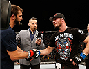 SYDNEY, AUSTRALIA - NOVEMBER 08:  (L-R) Opponents Luke Rockhold of the United States and Michael Bisping of England shake hands after their middleweight bout during the UFC Fight Night event inside Allphones Arena on November 8, 2014 in Sydney, Australia.  (Photo by Josh Hedges/Zuffa LLC/Zuffa LLC via Getty Images)