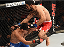 UBERLANDIA, BRAZIL - NOVEMBER 08:  Rodolfo Rubio of Mexico kicks Diego Rivas of Chile in their featherweight bout during the UFC Fight Night at Sabiazinho Gymnasium on November 8, 2014 in Uberlandia, Brazil.  (Photo by Buda Mendes/Zuffa LLC/Zuffa LLC via Getty Images)