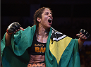 UBERLANDIA, BRAZIL - NOVEMBER 08:  Juliana Lima of Brazil celebrates after her victory over Nina Ansaroff of the United States in their strawweight bout during the UFC Fight Night at Sabiazinho Gymnasium on November 8, 2014 in Uberlandia, Brazil.  (Photo by Buda Mendes/Zuffa LLC/Zuffa LLC via Getty Images)
