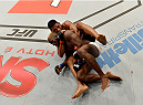 UBERLANDIA, BRAZIL - NOVEMBER 08:  Dhiego Lima of Brazil attempts to submit Jorge de Oliveira of Brazil in their welterweight bout during the UFC Fight Night at Sabiazinho Gymnasium on November 8, 2014 in Uberlandia, Brazil.  (Photo by Buda Mendes/Zuffa LLC/Zuffa LLC via Getty Images)