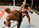 UBERLANDIA, BRAZIL - NOVEMBER 08:  Alan Jouban of the United States kicks Warlley Alves of Brazil in their welterweight bout during the UFC Fight Night at Sabiazinho Gymnasium on November 8, 2014 in Uberlandia, Brazil.  (Photo by Buda Mendes/Zuffa LLC/Zuffa LLC via Getty Images)