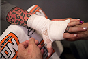 LAS VEGAS, NV - JULY 28:  Team Melendez fighter Bec Rawlings gets her hands wrapped before facing team Pettis fighter Tecia Torres during filming of season twenty of The Ultimate Fighter on July 28, 2014 in Las Vegas, Nevada. (Photo by Brandon Magnus/Zuffa LLC/Zuffa LLC via Getty Images) *** Local Caption *** Bec Rawling