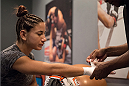 LAS VEGAS, NV - JULY 28:  Team Pettis fighter Tecia Torres gets her hands wrapped before facing team Melendez fighter Bec Rawlings during filming of season twenty of The Ultimate Fighter on July 28, 2014 in Las Vegas, Nevada. (Photo by Brandon Magnus/Zuffa LLC/Zuffa LLC via Getty Images) *** Local Caption *** Tecia Torres