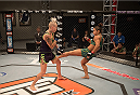 LAS VEGAS, NV - JULY 28:  (R-L) Team Pettis fighter Tecia Torres kicks team Melendez fighter Bec Rawlings during filming of season twenty of The Ultimate Fighter on July 28, 2014 in Las Vegas, Nevada. (Photo by Brandon Magnus/Zuffa LLC/Zuffa LLC via Getty Images) *** Local Caption *** Tecia Torres;Bec Rawlings