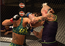 LAS VEGAS, NV - JULY 28:  (R-L) Team Melendez fighter Bec Rawlings exchanges punches with team Pettis fighter Tecia Torres during filming of season twenty of The Ultimate Fighter on July 28, 2014 in Las Vegas, Nevada. (Photo by Brandon Magnus/Zuffa LLC/Zuffa LLC via Getty Images) *** Local Caption *** Bec Rawling;Tecia Torres