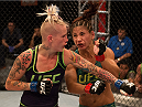 LAS VEGAS, NV - JULY 28:  (L-R) Team Melendez fighter Bec Rawlings exchanges punches with team Pettis fighter Tecia Torres during filming of season twenty of The Ultimate Fighter on July 28, 2014 in Las Vegas, Nevada. (Photo by Brandon Magnus/Zuffa LLC/Zuffa LLC via Getty Images) *** Local Caption *** Bec Rawling;Tecia Torres