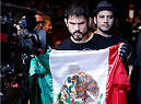 AUSTIN, TX - NOVEMBER 22:  Juan Puig of Mexico enters the arena before his featherweight bout against Doo Ho Choi of South Korea during the UFC Fight Night event at The Frank Erwin Center on November 22, 2014 in Austin, Texas.  (Photo by Josh Hedges/Zuffa LLC/Zuffa LLC via Getty Images)
