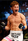 AUSTIN, TX - NOVEMBER 22:  Doo Ho Choi of South Korea celebrates after his TKO victory over Juan Puig of Mexico in their featherweight bout during the UFC Fight Night event at The Frank Erwin Center on November 22, 2014 in Austin, Texas.  (Photo by Josh Hedges/Zuffa LLC/Zuffa LLC via Getty Images)