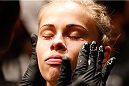 AUSTIN, TX - NOVEMBER 22:  Paige VanZant prepares to enter the Octagon before her women's bantamweight bout against Kailin Curran during the UFC Fight Night event at The Frank Erwin Center on November 22, 2014 in Austin, Texas.  (Photo by Josh Hedges/Zuffa LLC/Zuffa LLC via Getty Images)