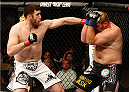 AUSTIN, TX - NOVEMBER 22:  (L-R) Ruslan Magomedov of Russia punches Josh Copeland in their heavyweight bout during the UFC Fight Night event at The Frank Erwin Center on November 22, 2014 in Austin, Texas.  (Photo by Josh Hedges/Zuffa LLC/Zuffa LLC via Getty Images)